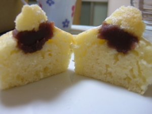 Inside the fluffy sponge cupcakes, showing the red bean jam inside.