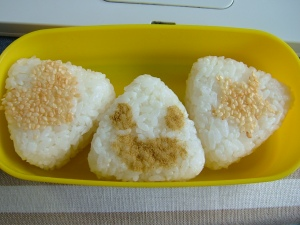 My first attempt at making onigiri, ready in the second layer of my bento for lunch tomorrow.