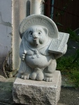Tanuki with an abacus statue.