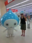 Lara in K's electrical store with the water droplet aircon mascot.