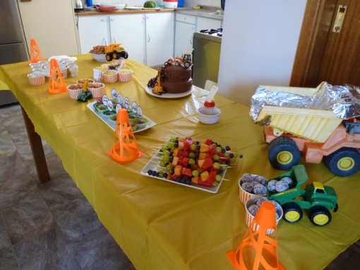 the table set up with food and traffic cones