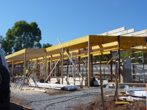 Internal timber frame on the upper level going in, with all roof timbers in and the pergola timbers also.