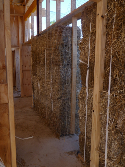 Looking down hallway one at the sections of straw bale wall.