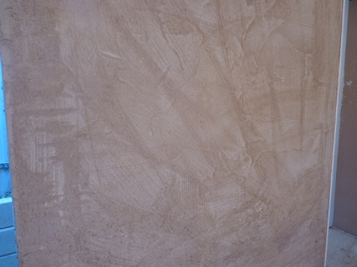 Texture on the wall - render is smoothed on then brushed to provide texture for the third coat to stick to.