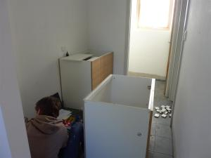 Laundry cupboards being installed